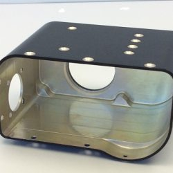 A silver and black box shaped piece of machinery